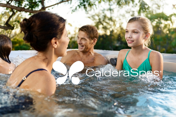 a family relaxes in on an outdoor patio in a caldera spa