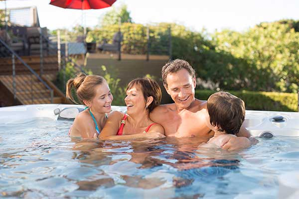 Image of a family enjoying quality family time in the world's best hot tub brand