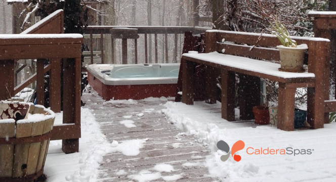 winter scene of hot tub on a deck in the snow
