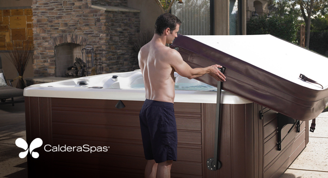 a man demonstrates the ease of use with an energy efficient hot tub cover and hot tub cover lifter