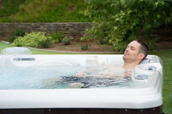 A man enjoys a cold water hot tub therapy experience after exercise
