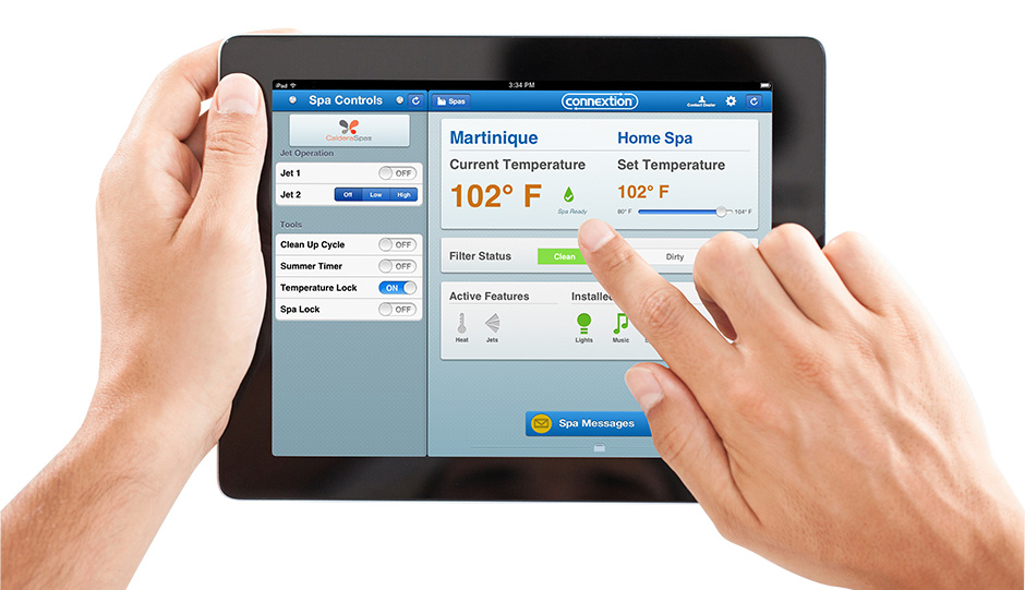 two hands hold an ipad an operate the online remote hot tub control system