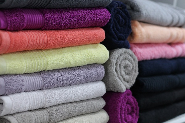stack of colorful bath towels represents the variety of hot tub choices