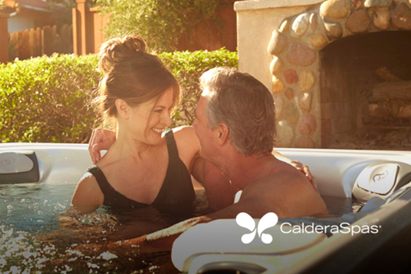 couple in a hot tub enjoys a successful hot tub installation