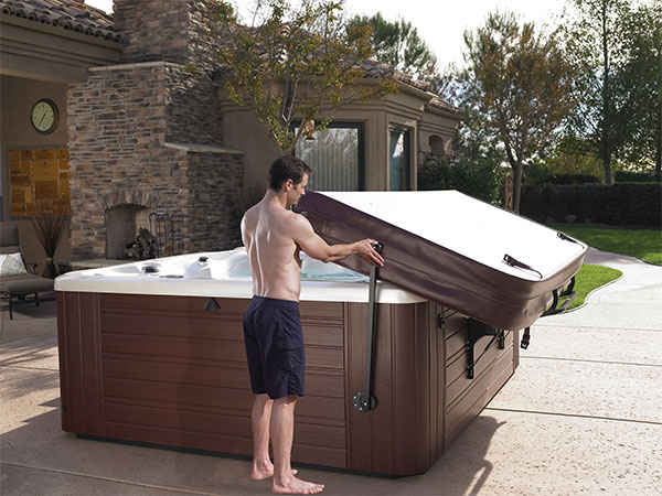 A man demonstrates that hot tub cover lifters make you spa easy to open
