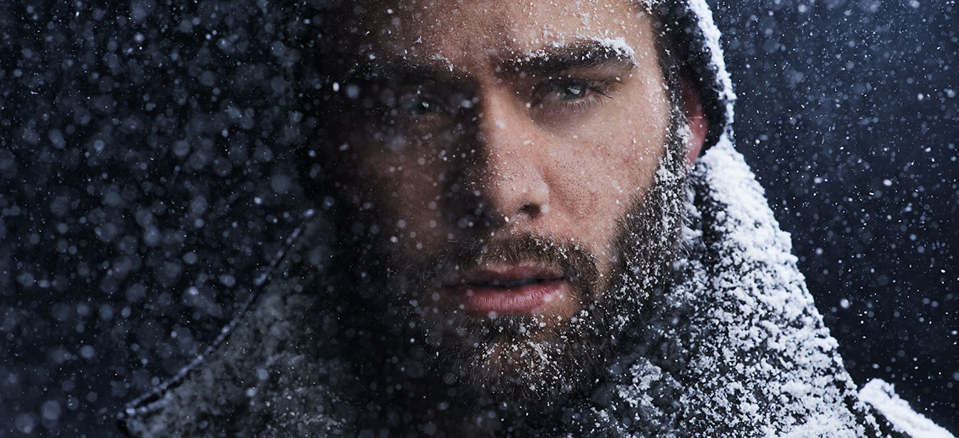 a man with snow in his beard reminds us that the benefits of time spent in a spa is good for mental health in winter