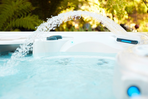 Caldera water fall feature creates a relaxing ambiance to enhance the hot tub experience